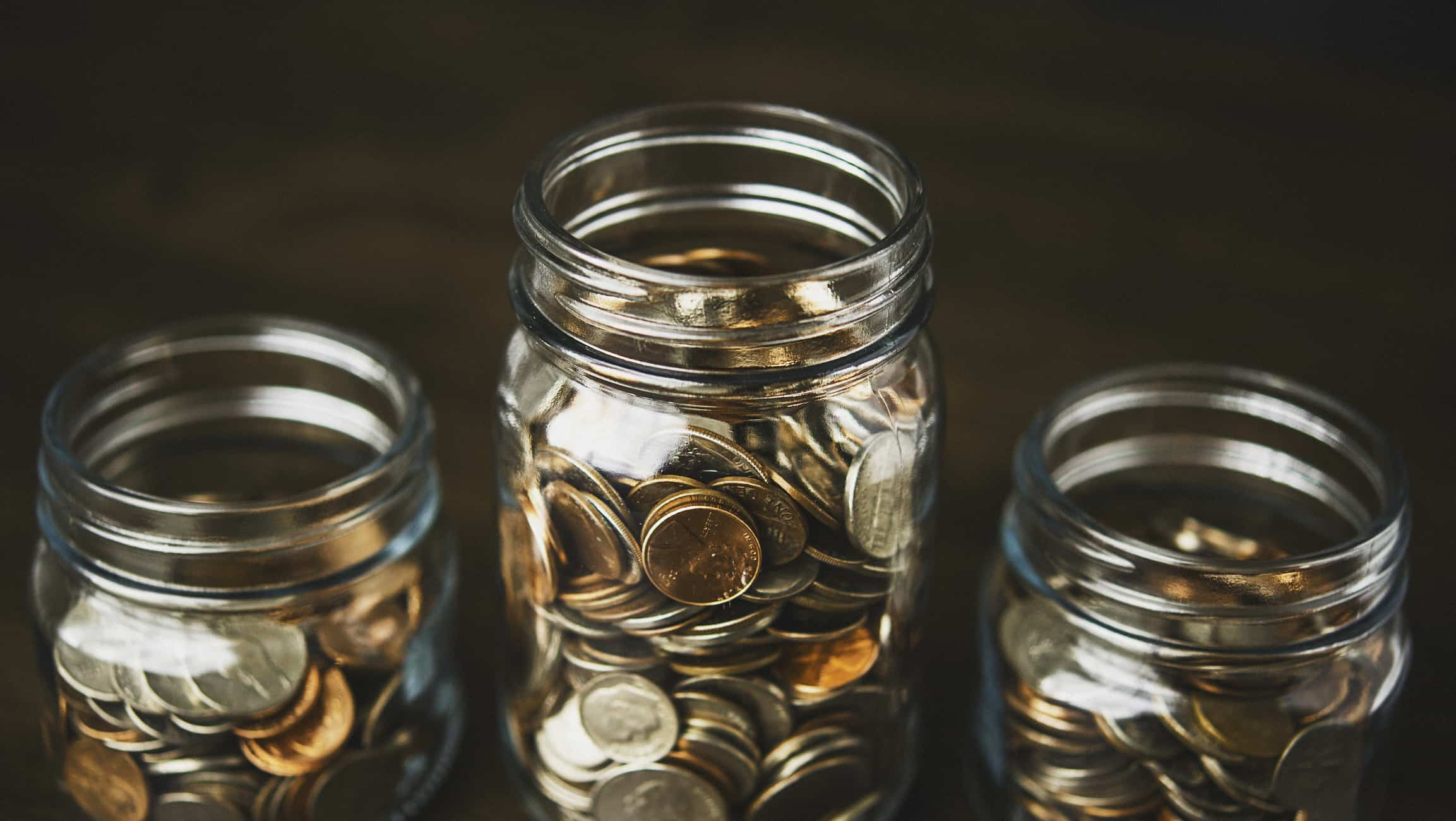 three jars full of money, coins