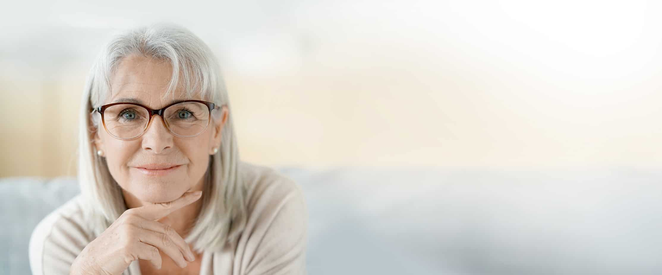 Senior Woman Subtle Smile - Header Image