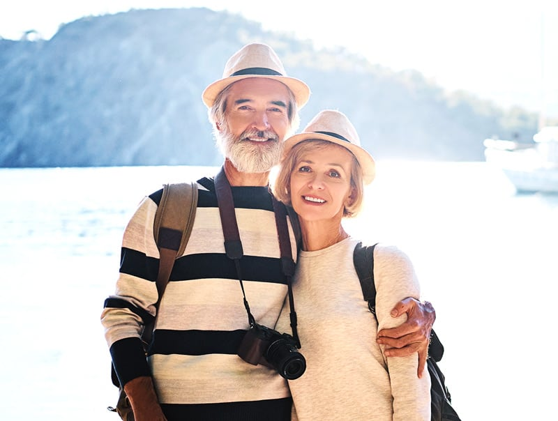 Lively Senior Couple Traveling Posing