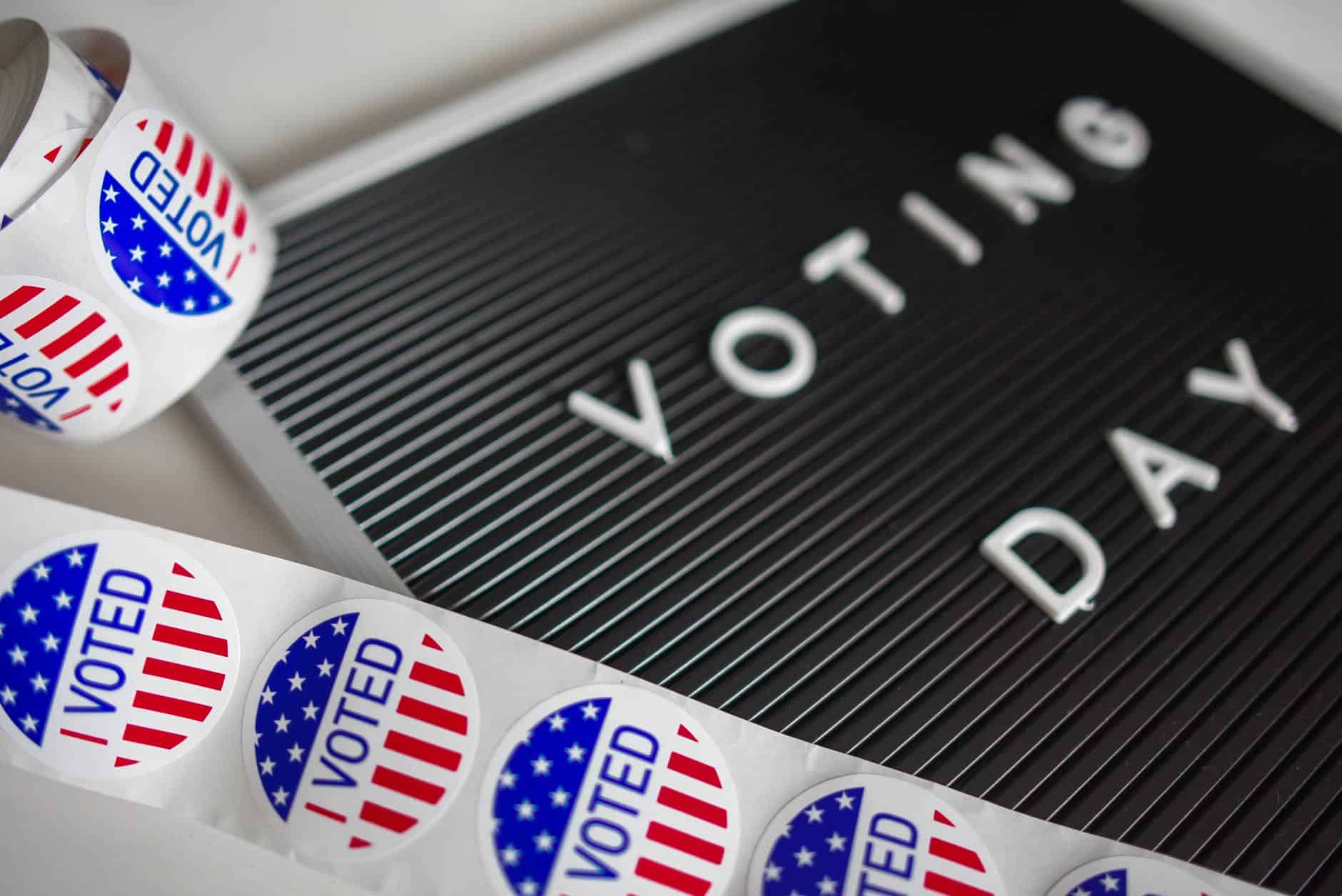 Voting day sign with I voted stickers