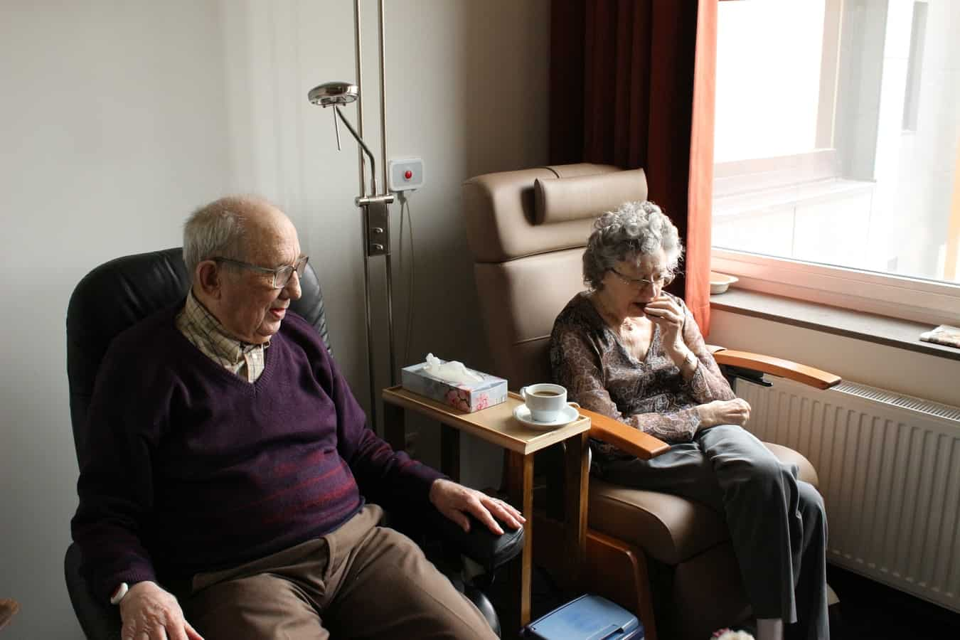 Older couple sitting in chairs