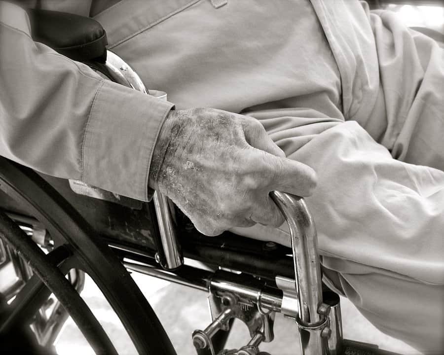 elderly man in wheel chair