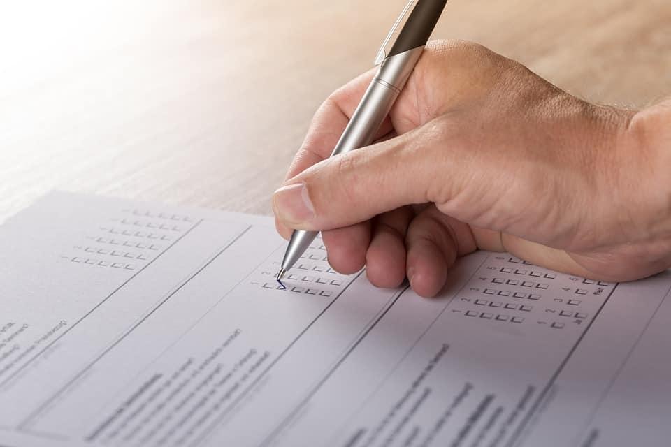 Person taking survey, checking box