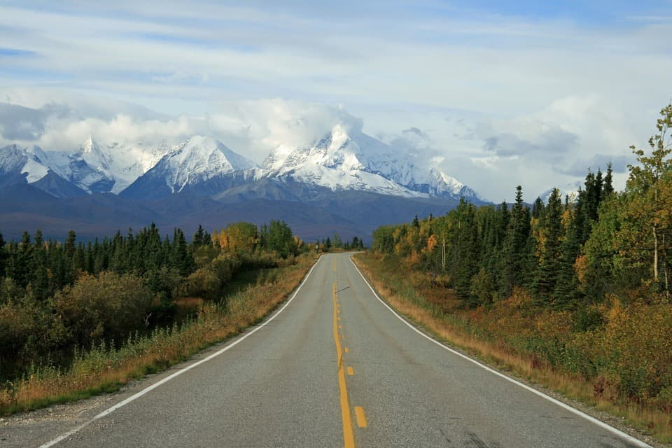 Road leading to mountains in Alaska