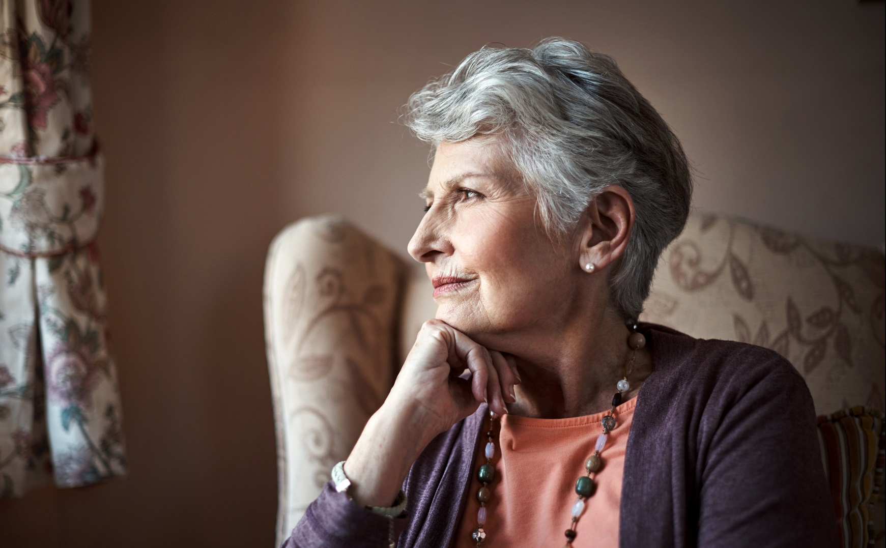 elderly woman gazing out window