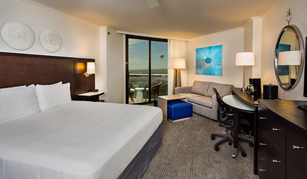 hotel room interior with king size bed and sitting area