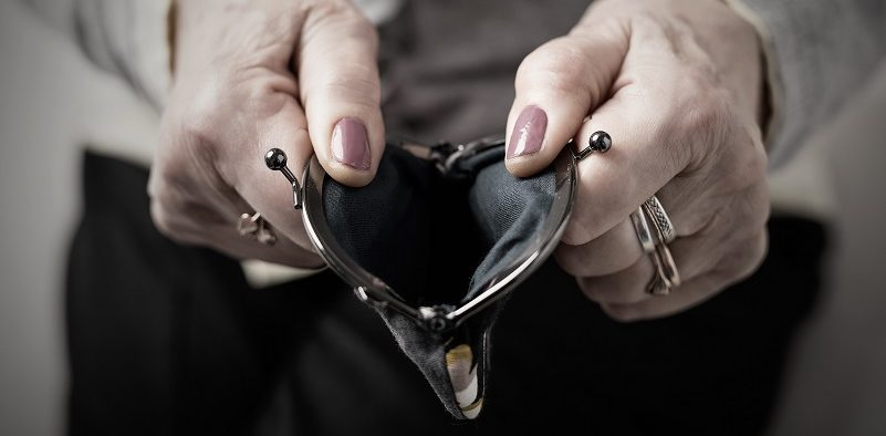 woman-holding-empty-coin-purse