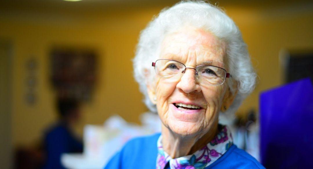 elderly woman in blue shirt
