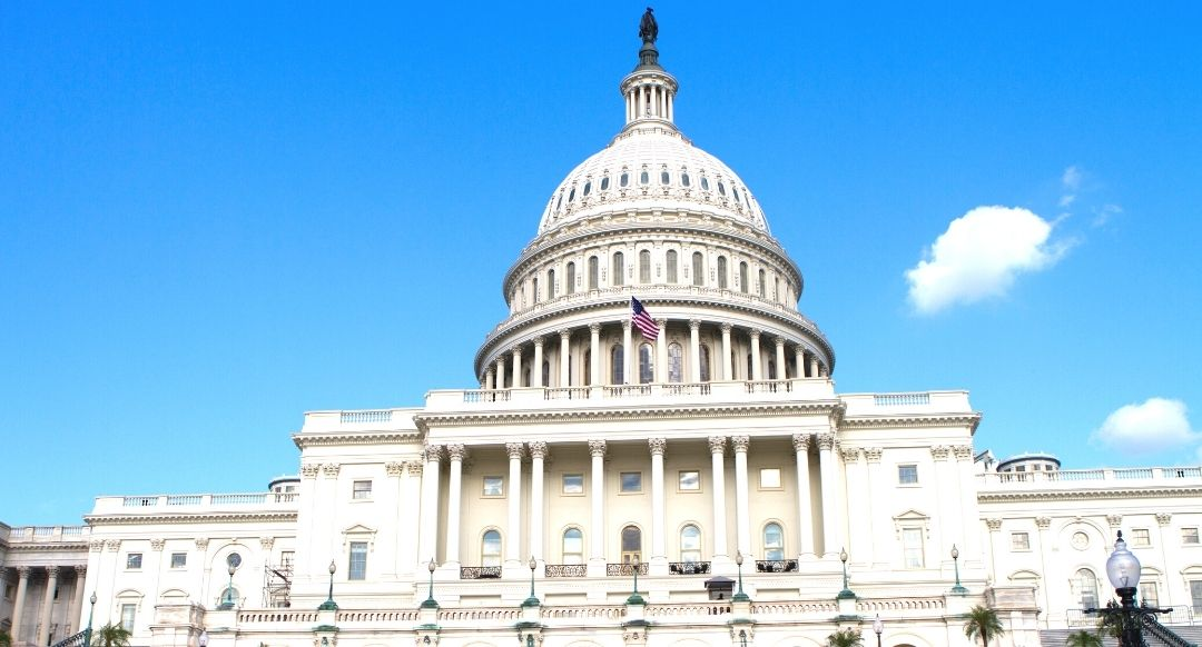 United States capitol building against bright blue sky